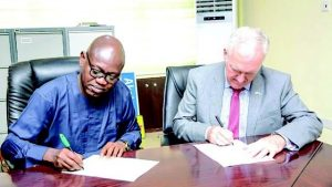 Secretary to Ogun State Government, Tokunbo Talabi (left), signing the Memorandum of Understanding on 'Future Cities Nigeria' with Guy Harrison of the British High Commission, in Abeokuta